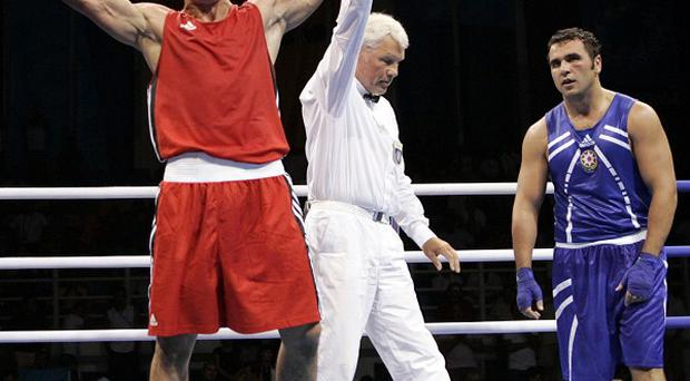 Syrian boxer Nasser al-Shami, left, in the ring; the former Olympic champion has been shot in unrest in Hama(AP)