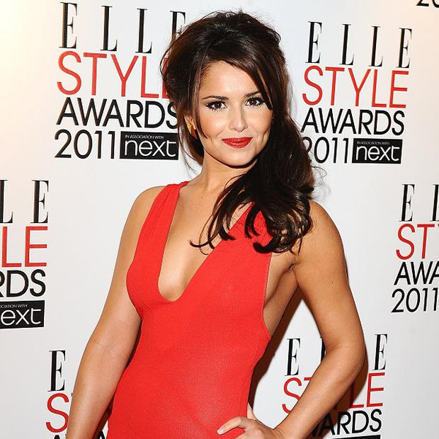Cheryl Cole is reportedly back with ex-husband Ashley