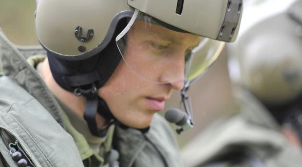 Prince William heads toward a Sea King helicopter for a training exerciseas part of his Canadian tour(AP)