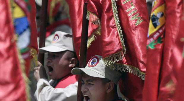 Venezuela's Bolivarian Militias march during a parade marking 200 years of the country's independence from Spain (AP)