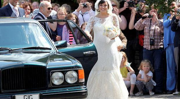 Singer Lily Allen stands next to the limo with personalised plates sold by Speedy Registrations