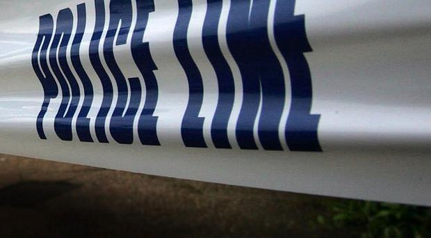 A man has been arrested after the body of a woman was discovered at a village shop in Kewstoke, near Weston-super-Mare