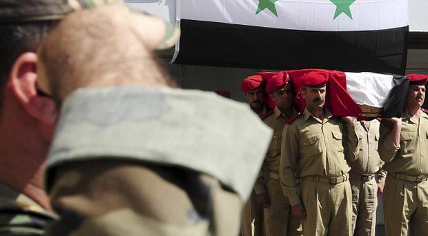 Syrian forces have been accused of slaughtering helpless civilians (AP)