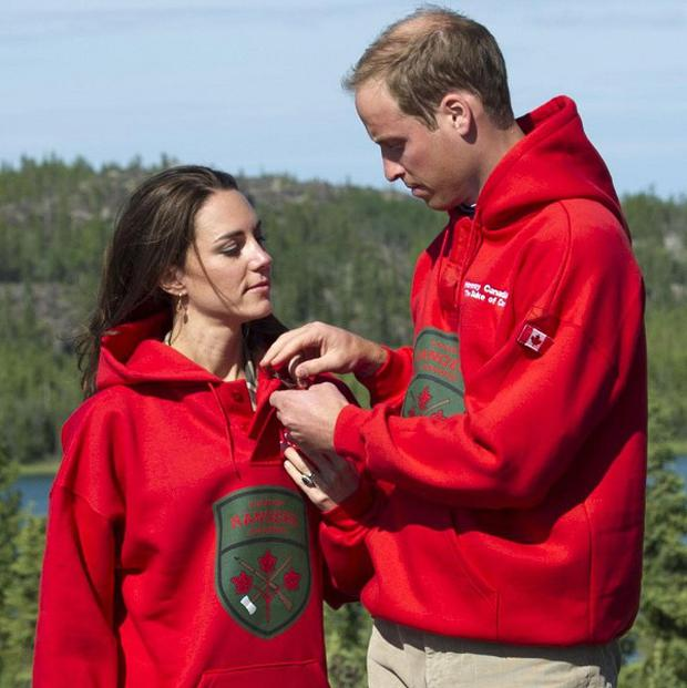 William adjusts Kate's hood during a visit to Blachford Lake, near Yellowknife