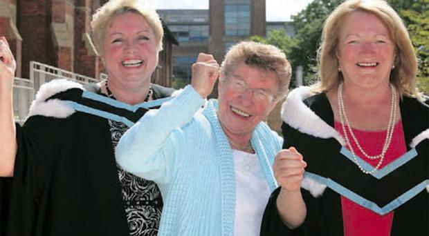 Kate McGahey (58) from Twinbrook and Marion Malloy (57) from Dunmurry celebrate with their mother May Brownlee