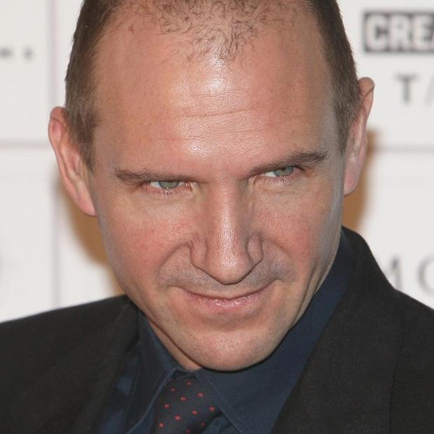Harry Potter star Ralph Fiennes said he was relieved to get rid of the irritating costume he had to wear while playing Lord Voldemort