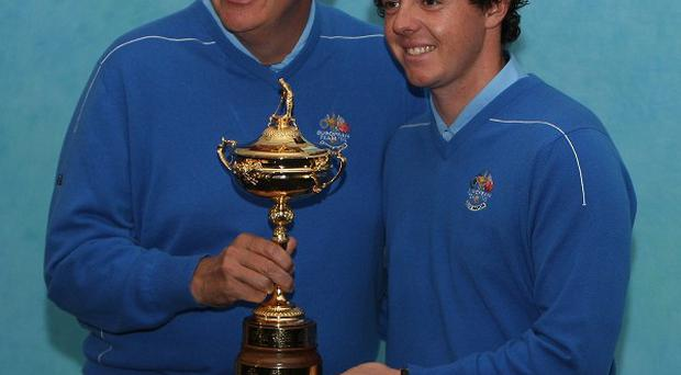 Colin Montgomerie and Rory McIlroy (right)
