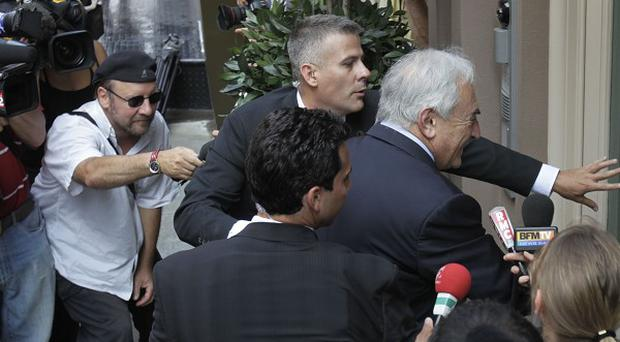 Former International Monetary Fund chief Dominique Strauss-Kahn was surrounded by media while returning to his rented New York house