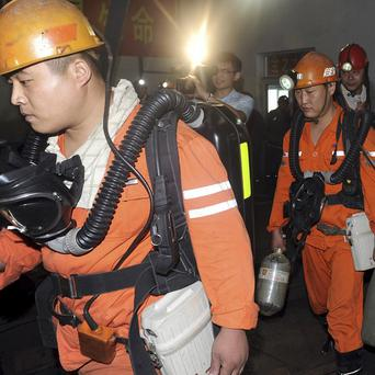 Rescuers prepare to enter the Fangbei coal mine that caught fire in Zaozhuang, in east China's Shandong province (AP)