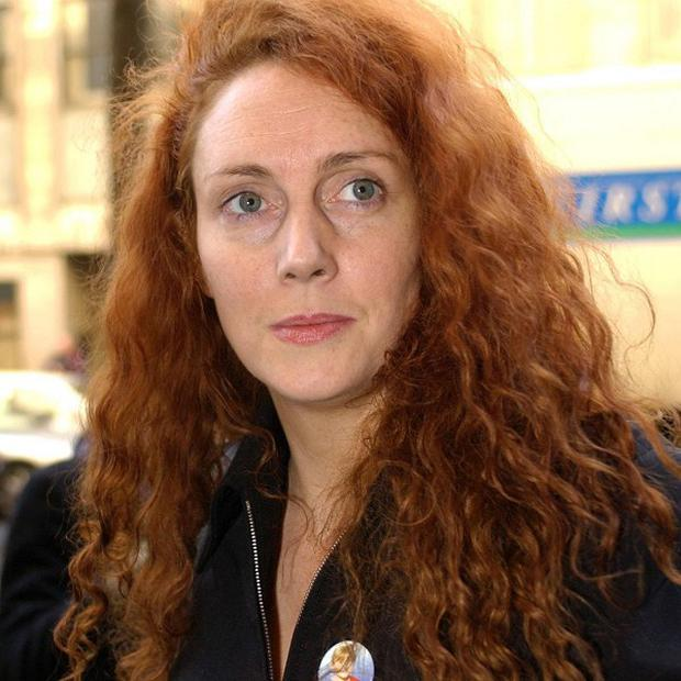 An MP has called for News International chief executive and former News of the World editor Rebekah Brooks to resign