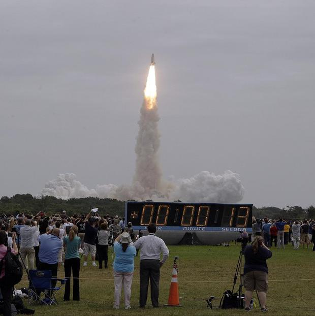 The space shuttle Atlantis takes off from the Kennedy Space Centre (AP)