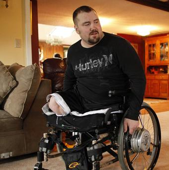 Sgt James Hackemer, a US army veteran who lost his legs in Iraq, was killed after being thrown from a 200-foot-tall rollercoaster (AP)