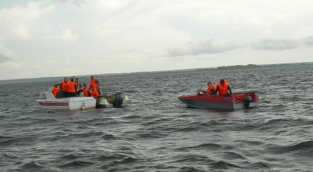 Rescue boats seek passengers from a tourist boat that sank on the Volga River in central Russia (AP)