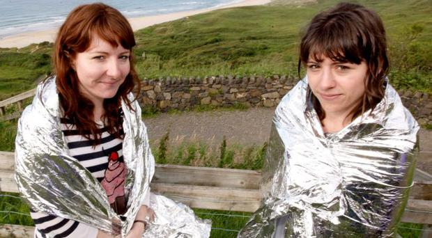 Laura and Hayley Sherwin, from Glengormley, who helped save a man and his son in difficulty in the sea at Whitepark Bay yesterday
