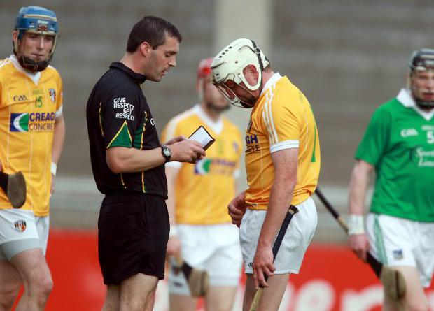 Off you go: Antrim's Karl Stewart gets a red card from referee James Owens as his side went down to Limerick on Saturday