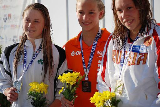Silver lining: Ireland's Sycerika McMahon (left) proudly shows off her silver medal alongside Russia's Ksenia Yuskova (right) and Holland's Esmee Vermeulen (centre)