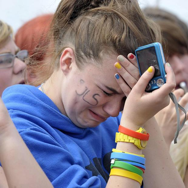 A JLS Fan cries after it was announced that they had cancelled their appearance at T4 on the Beach in Weston-super-Mare