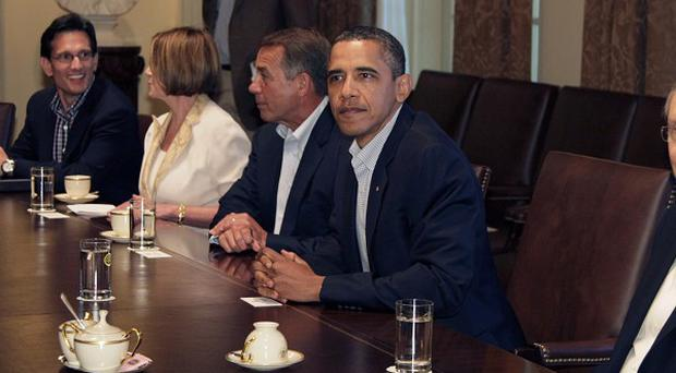 President Barack Obama met House of Representatives and Senate leaders for talks over a plan to avoid an unprecedented default on US debt (AP)