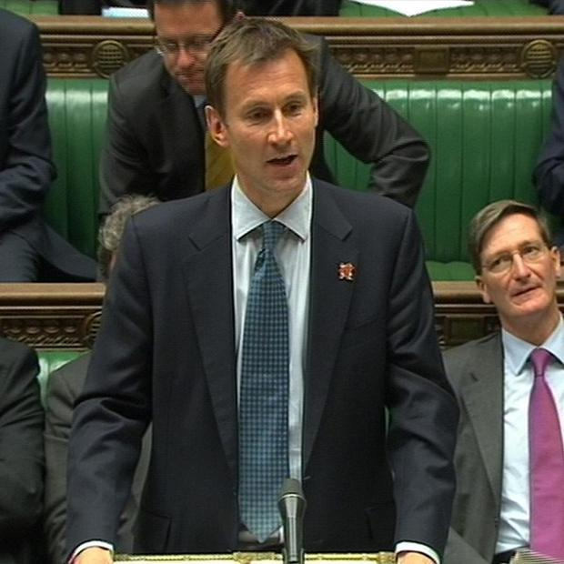 Culture Secretary Jeremy Hunt has told MPs he is referring News Corp's BSkyB bid to the Competition Commission