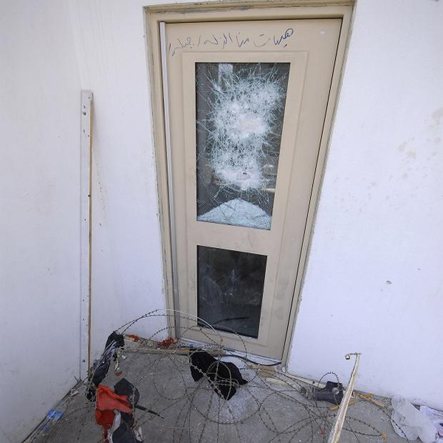 A smashed window at the US Embassy in Damascus after pro-Syrian government protesters attacked the compound(AP)