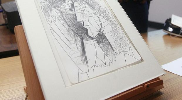 The 1965 pencil-on-paper Picasso drawing titled 'Tete de Femme' (AP)