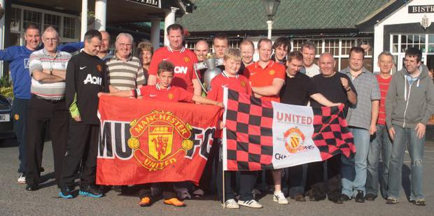 United they stand: Young and old members of the Carryduff Manchester United supporters Club