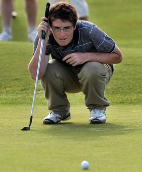 Looking ahead: Dermot McElroy reads the putting green yesterday