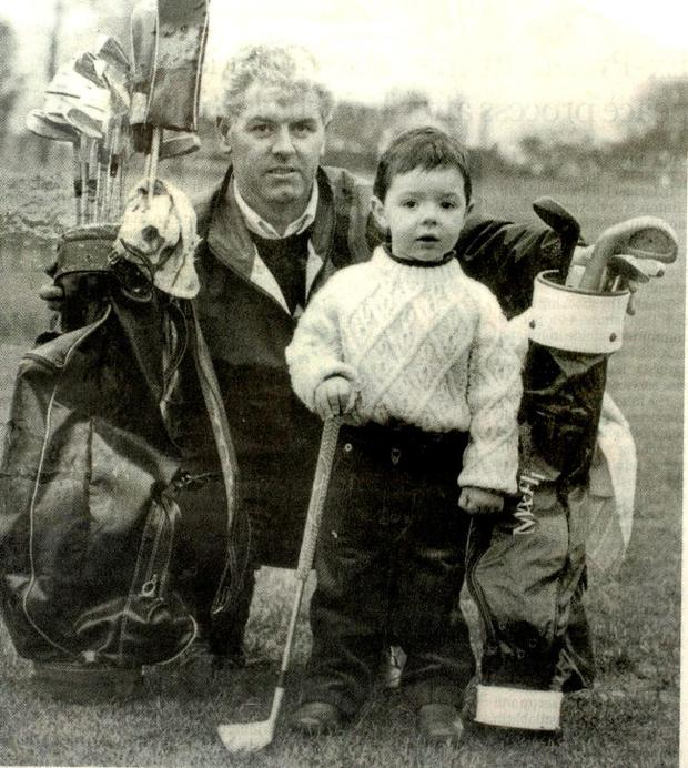 That's my boy: Gerry McIlroy with three-year-old Rory