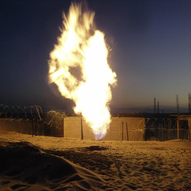 Masked gunmen have blown up a terminal of the Egyptian natural gas pipeline to Israel and Jordan (AP)