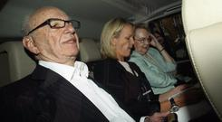 Rupert Murdoch (L), the chief executive officer of News Corp