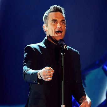 Robbie Williams says fans should expect swearing when they watch him perform live