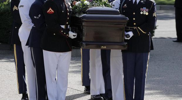 A military honour guard carries the coffin bearing the body of former first lady Betty Ford (AP)