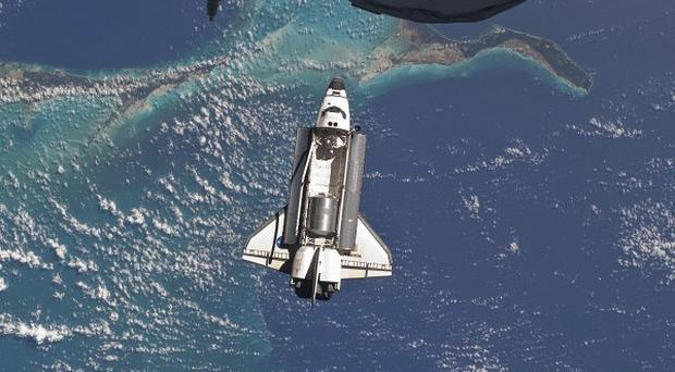 The shuttle astronauts have dealt with another computer problem aboard Atlantis