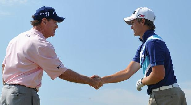 Tom Watson of the United States is congratulated by Amateur Tom Lewis of England (R) after his hole in one at the sixth hole during the second round of The 140th Open Championship at Royal St George's