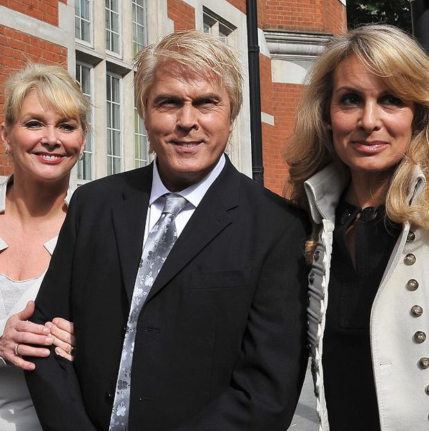 Former Bucks Fizz members Cheryl Baker, left, Mike Nolan and Jay Aston arrive at the Trade Mark Registry in London
