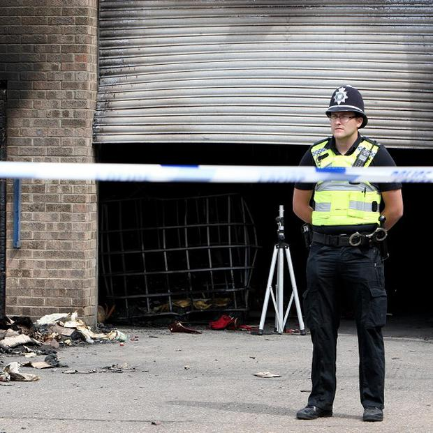 Police attend the scene of an explosion at the Broadfield Lane industrial estate in Boston, Lincolnshire