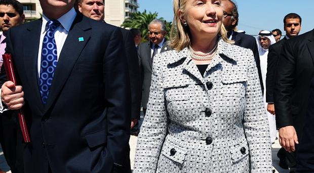 Foreign Secretary William Hague and US Secretary of State Hillary Clinton arrive for a meeting of Libya Contact Group in Istanbul, Turkey (AP)