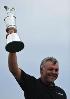 SANDWICH, ENGLAND - JULY 17: Darren Clarke of Northern Ireland lifts the Claret Jug aloft following his victory at the end of the final round of The 140th Open Championship at Royal St George's on July 17, 2011 in Sandwich, England. (Photo by Stuart Franklin/Getty Images)