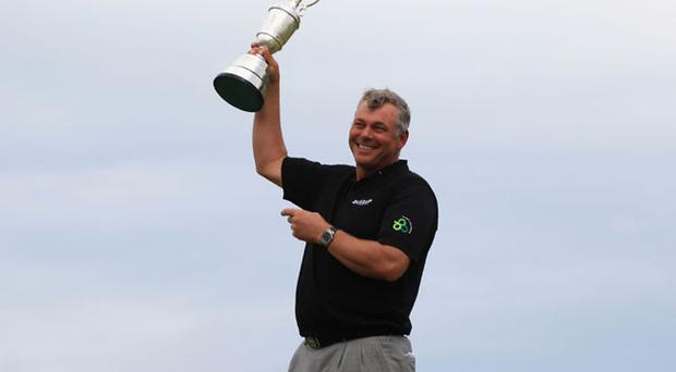 Darren Clarke of Northern Ireland holds the Claret Jug aloft following his victory at the end of the final round of The 140th Open Championship at Royal St George's on July 17, 2011 in Sandwich, England