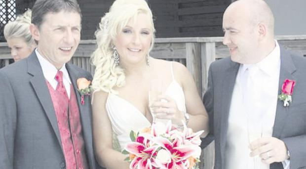Ciara with her father Eamonn (left) and husband Stephen on their wedding day in Clearwater, Florida <p><b>To send us your Wedding Pics <a href=