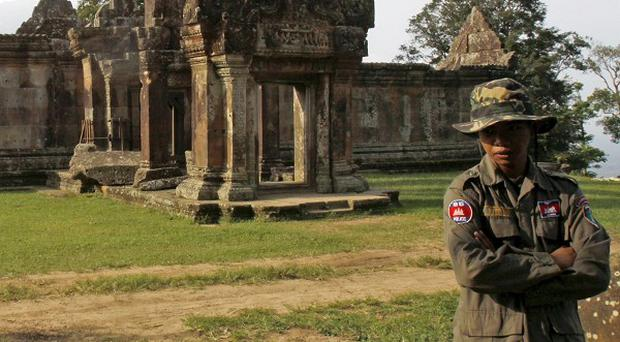 Judges have ordered military forces to withdraw from the Hindu Preah Vihear temple in Cambodia (AP)
