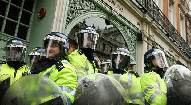 Riot police outside Fortnum and Mason during the 'March for the Alternative' demonstration against government spending cuts in London