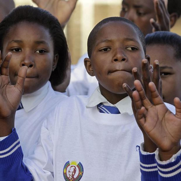 Children sing in celebration of Nelson Mandela's birthday at a museum near his house in Qunu, South Africa (AP)