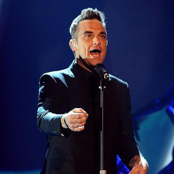 Take That have had to cancel a show after Robbie Williams suffered food poisoning