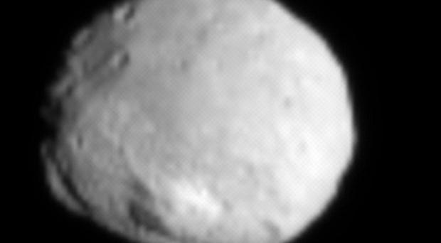 This image of the asteroid Vesta was captured by the Dawn spacecraft (AP/Nasa)