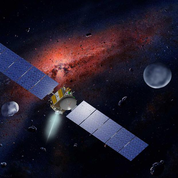 An artist's impression of the Dawn spacecraft with Ceres and Vesta seen in the background (AP/Nasa/William K Hartmann)