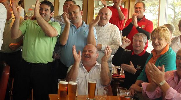 Fans at Dungannon Golf Club, Northern Ireland, Darren Clarke's home club, celebrate his Open Championship victory