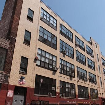 FBI officers probing hacker group Anonymou searched homes and seized computers at a loft building at 255 McKibbin Street in Brooklyn, New York (AP)