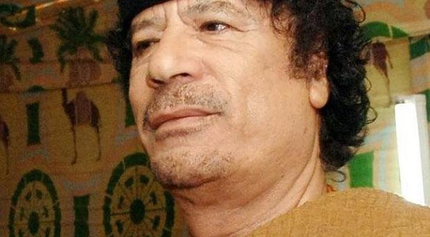 A French official has suggested Colonel Muammar Gaddafi may be able to live in Libya if he hands over power