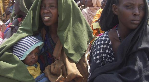 Somali women hit by drought wait to receive rations at a camp in Mogadishu (AP)